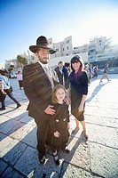 Jewish family near wailing wall on before Sundown & Sabbath