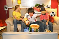 football fans excited in front of tv, women pouting
