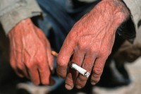 cigaret in the hand of an old man, Iran