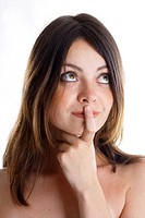 young woman with forefinger at the mouth