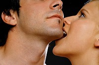 young woman biting man in his chin