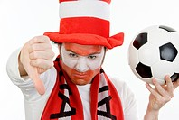 disappointed Austrian soccer fan makes thumb down