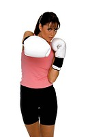 young woman in white boxing gloves shoots a strong right cross during a boxing workout