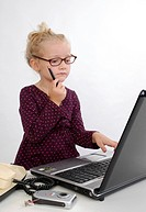 little business woman with laptop in office