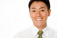 A young chinese businessman in white shirt green tie