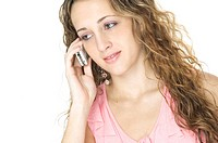 An attractive young female uses a cellphone
