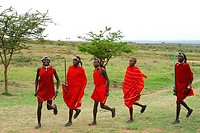 Maasai warriors perform welcome dance Masai Mara Tribal village Kenya East Africa