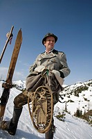 skier in old_fashioned clothing with wooden ski and snow shoes