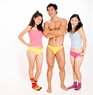Two pretty asian women with a muscular guy in underwear
