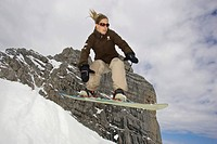 female snowboarder jumping
