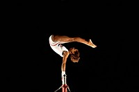gymnast on high bars