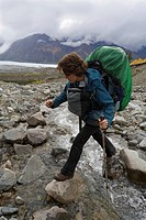 Hiker, backpacker, crossing creek, woman, Donjek Route, St. Elias Mountains, Kluane National Park, Yukon Territory, Canada, North America