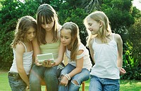 Group of girls playing with Gameboy