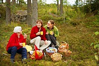 Women having coffee break in forest