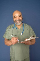 Mature doctor holding clipboard, portrait