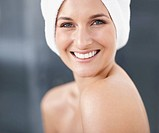 Pretty girl with towel wrapped on head