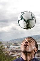 Young man looking at football