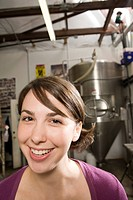 Portrait of young woman working in a brewery