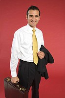 Smiling businessman carrying briefcase