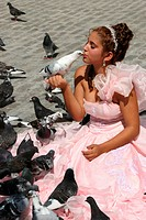 girl in festive dress kisses a dove in the old town, Cuba, La Habana