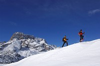 Snowshoe hikers on the Plaetzwiese Meadow, at back the Hohe Gaisl Mountain, High Puster Valley or Alto Pusteria, Bolzano_Bozen, Dolomite Alps, Italy, ...