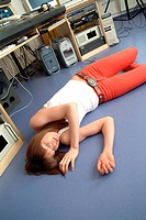 Unconscious young woman lying on the floor of a recording studio