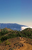 A couple of hikers on the ruta de los volcanes with the edge of the Caldera crater de Taburiente at the back, Canary, La Palma