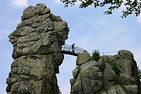 at rocks of the Externsteine, one person crosses the pedestrian bridge between two rocks, Germany, North Rhine_Westphalia, Horn_Bad Meinberg