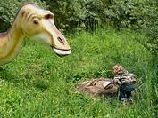 Edmontosaurus Edmontosaurus, little boy inspecting a dinosaur´s nest