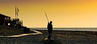 angler at sunset, Netherlands, Zeeland, Zoutelande