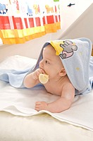 Baby wearing a hooded towel