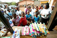 Women distributing school materials to school children, Women's Education Centre, Bamenda, Cameroon, Africa
