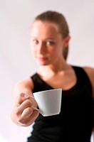 Blond woman in black top with a cup of coffee in hand