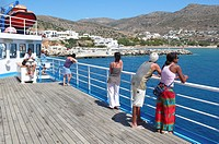 Passengers on the deck of a car ferry, Port of Folegandros, Cyclades, Greece, Europe