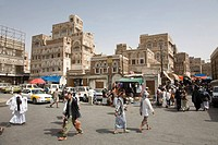Souk, buildings made of brick clay, marketeers, square in front of the Bab El Yemen, San'a', UNESCO World Heritage Site, Yemen, Middle East