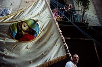 Naples, Italy  A man carries a banner with the image of Jesus Christ during the festival of San Gennaro, Naples' patron saint