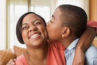African boy kissing mother