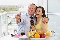Hispanic couple taking self_portrait with cell phone