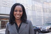African businesswoman standing on urban street