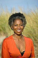 Smiling African woman at beach
