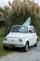 Italy, Tuscany, Car with surfboard