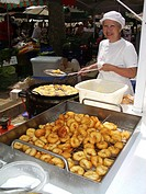 woman cooking typical majorcan snacks Bunuelos on the market, Spain, Balearen, Majorca, Alcudia