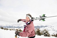 Italy, South Tyrol, Seiseralm, Man carrying skis, portrait