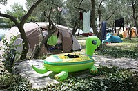 Campsite at Kovacine Campground, with its concrete beach, swimming, and boat docks, Cres Island, Croatia, Europe