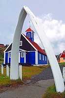 traditional colourful wooden church in a Greenland fishing village in the fjordlands, Greenland