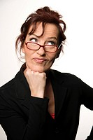 Woman in business dress looking sceptically over her glasses