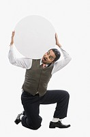 Businessman carrying a blank circular placard