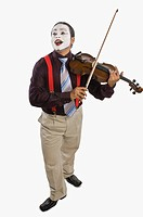 Mime playing a violin