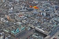 Eurocopter Medicopter BK 117 flying over city hall, Hamburg, Germany, Europe