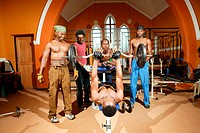 Young men working out at a church that's been converted into a gym, Capetown, South Africa, Africa